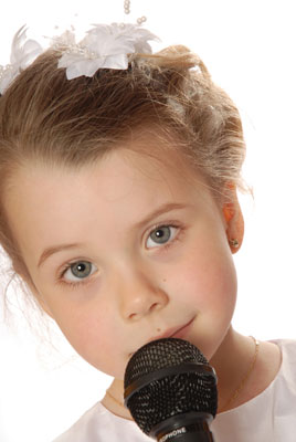 young girl singing with a microphone